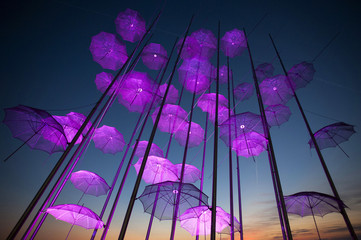 """""""Umbrellas"""", the sculpture by Giorgos Zogolopoulos is illuminated in pink light to mark Breast Cancer Awareness Month in Thessaloniki in northern Greece"""