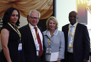Attendees pose for pictures at the opening of the Nigeria Oil & Gas 2014 conference in Abuja
