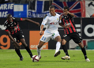 Olympique Marseille's Remy challenges Nice's Abriel and Diakite during their French Ligue 1 soccer match at the Velodrome stadium in Marseille