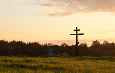 Summer landscape and silhouette of orthodox cross.
