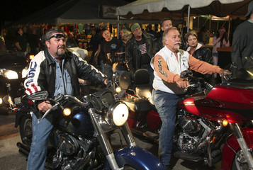 Competitors wait to enter Suck Bang Blow biker bar during a slow ride competition in Murrells Inlet
