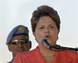 Brazilian President Dilma Rousseff speaks to Brazilian peacekeepers while touring the military base in Port-au-Prince