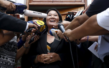 Peru's presidential candidate Keiko Fujimori talks to reporters after a meeting at Peru's electoral board in Lima