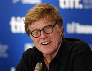 U.S. director Robert Redford smiles during a news conference at the 35th Toronto International Film Festival in Toronto