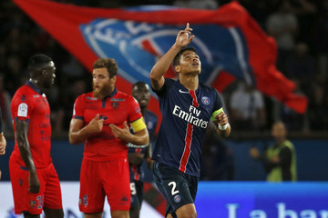 Paris St Germain's Thiago Silva celebrates after his goal during their French Ligue 1 soccer match against Ajaccio at the Parc des Princes Stadium in Paris