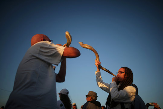Jared Stein plays the shofar during the Nashuva Spiritual Community Jewish New Year celebration on Venice Beach in Los Angeles