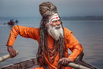 Portrait of sadhu rowing in the boat, Varanasi, India. Wall mural
