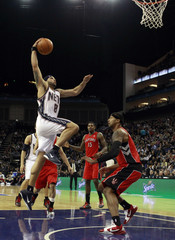 New Jersey Nets guard Deron Williams scores a basket against Toronto Raptors in their NBA basketball game in London