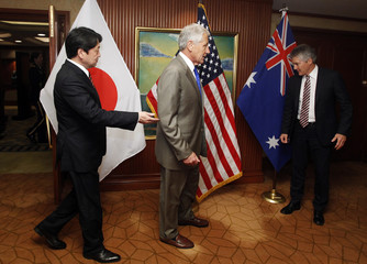 Defence ministers of the U.S., Japan and Australia take up position to pose at  IISS Asia Security Summit in Singapore