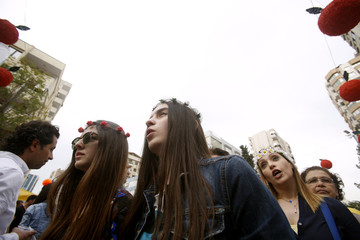 Women wear flowers in their hair during the annual carnival celebration of the start of the spring season in Adana city