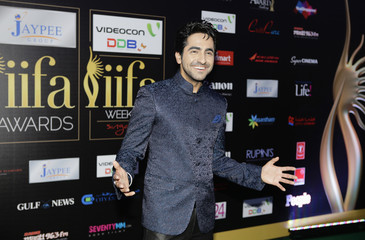Bollywood actor Ayushman Khurana poses for a picture as he arrives on the green carpet for the International Indian Film Academy (IIFA) Awards show in Singapore June 9, 2012. REUTERS/Tim Chong/Files