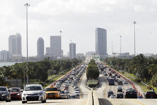 Traffic leading towards Art Basel on Miami Beach is seen with the skyline of midtown Miami in the background