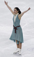 Faiella of Italy reacts after performing at the ice dance free dance event at the World Figure Skating Championships in Turin