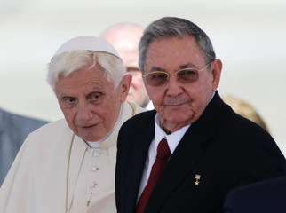 Pope Benedict XVI and Cuba's President Raul Castro stand together after the Pope's arrival in Santiago de Cuba