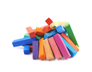 Pile of colorful pastel crayon chalks isolated