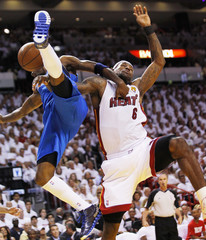 Mavericks' Terry is fouled by Heat's James during Game 1 of the NBA Finals basketball series in Miami