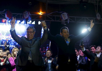 Guatemala's President-elect Jimmy Morales and his Vice President Jafeth Cabrera celebrate after winning the presidential elections in Guatemala City