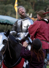 Australian jousting knight Luke Binks reacts after taking off his helmet after being eliminated from the final of the jousting competition the St Ives Medieval Fair in Sydney