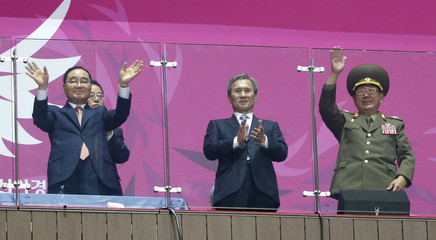 South Korea's Prime Minister Jung, former South Korean minister for national defense Kim and North Korea's Hwang attend the closing ceremony of the 17th Asian Games at the Incheon Asiad Main Stadium