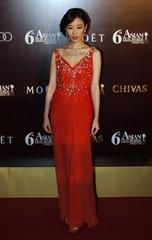 Chinese actress Ni poses at the Asian Film Awards in Hong Kong