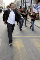 U.S. director and producer Quentin Tarantino, the jury president of the 67th Venice Film Festival, walks on the street of Lido in Venice
