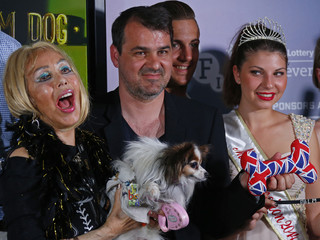 Director Kornel Mundruczo poses next to Cannes popular figure Emogin Diamonds and her dog James Blond, during the Palm Dog awards ceremony at the 67th Cannes Film Festival in Cannes