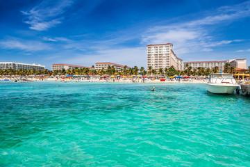Fototapete - Palm Beach is a popular spot for enjoying Aruba's sun and water sports