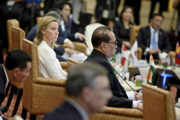EU foreign policy chief Federica Mogherini listens during the 22nd Southeast Asian Nations (ASEAN) Regional Forum at the Putra World Trade Center in Kuala Lumpur