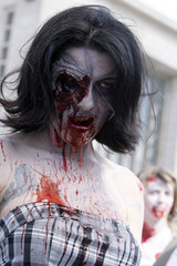A woman dressed like a  zombie takes part in a parade at the Brussels International Fantasy Film Festival