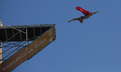 Czech Republic's Navratil performs an exhibition dive dressed as Superman at the end of the men's 27m high diving final  during the World Swimming Championships in Barcelona