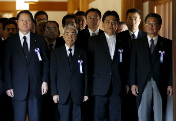 A group of lawmakers walks as they offer prayers at Yasukuni Shrine in Tokyo