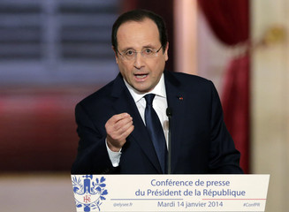 French President Hollande addresses a news conference at the Elysee Palace in Paris