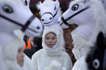 Revellers dressed in costumes prepare for a parade celebrating Chinese New Year, the Year of the Horse, in central London