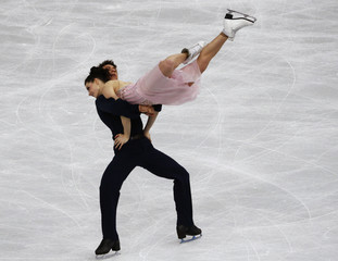 Canada's Tessa Virtue and Scott Moir compete during the Figure Skating Ice Dance Free Dance Program at the Sochi 2014 Winter Olympics