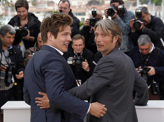 Director Vinterberg and cast member Mikkelsen pose during a photocall for the film Jagten at the 65th Cannes Film Festival