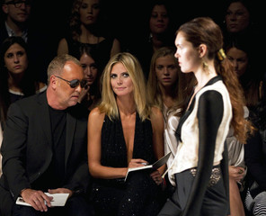 Judges Klum and Kors watch as a model presents a creation at the 2012 Project Runway show during New York Fashion Week