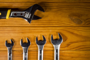 Adjustable wrench and wrenches