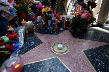 Flowers and mementos adorn the star of late Mexican singer Juan Gabriel on the Hollywood Walk of Fame in Los Angeles