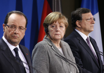 German Chancellor Merkel French President Hollande and European Commission President Barroso give news conference in Berlin