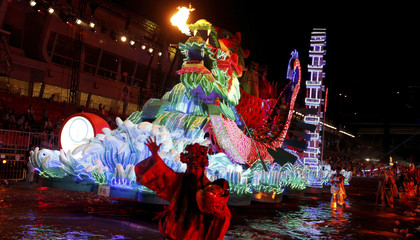 Performers accompany a dragon float during a dress rehearsal for the Chingay parade in Singapore