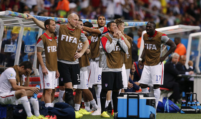U.S national soccer players react during extra time in the 2014 World Cup round of 16 game between Belgium and the U.S. at the Fonte Nova arena