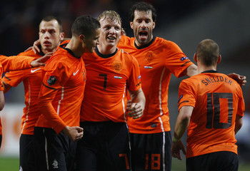 Netherlands' players celebrate a goal by Kuyt against Hungary during their soccer match at the Amsterdam Arena stadium