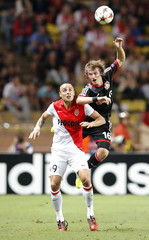 AS Monaco's Berbatov fights for the ball with Bayer Leverkusen's Jedvaj during their Champions League Group C soccer match at Louis II stadium in Monaco