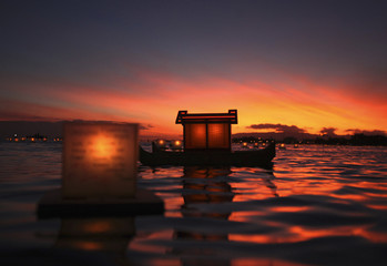 Lanterns float on water after being released during ceremony marking remembrance and reflection, held by Shinnyo-en Buddhist organization, honoring victims of war, famine, and natural disasters on Memorial Day in Honolulu