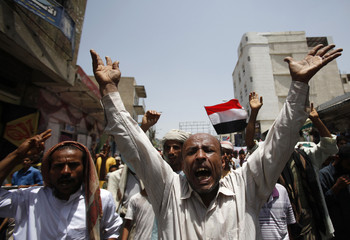 Anti-government protesters shout slogans during a demonstration to demand the ouster of Yemen's President Saleh in Taiz