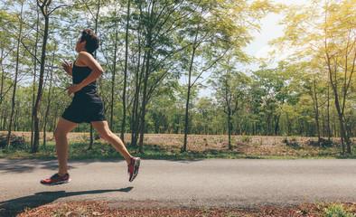 Asian man running in the park in summer.motion blur runner