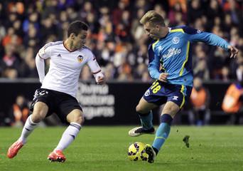 Sevilla's Gerard Deulofeu and Valencia's Rodrigo Moreno fight for the ball during their Spanish first division soccer match in Valencia