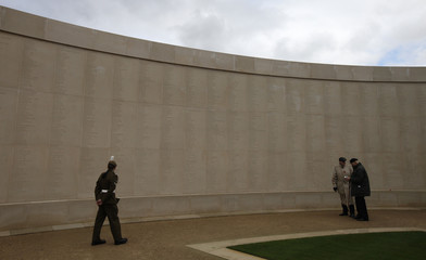 Veterans and servicemen look at the armed forces memorial during Remembrance day commemorations at the National Memorial Arboretum in Alrewas, central England