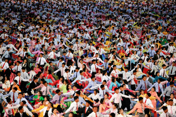 People participate in a mass dance in the capital's main ceremonial square, a day after the ruling Workers' Party of Korea party wrapped up its first congress in 36 years, in Pyongyang