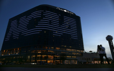 The NCAA logo is seen on the side of a hotel in Dallas, Texas